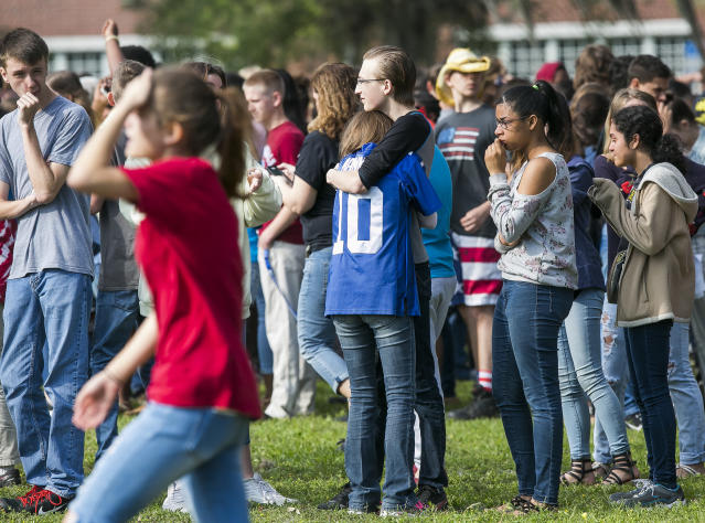 <p>Forest High School students console one another after a school shooting at Forest High School Friday, April 20, 2018 in Ocala, Fla. (Photo: Doug Engle/Star-Banner via AP) </p>