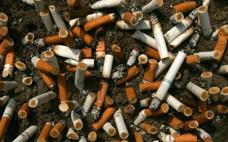 Cigarette butts fill an ashtray outside a construction site in Central