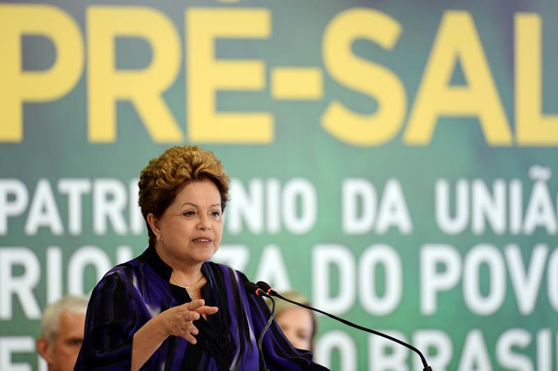 File photo shows Brazilian President Dilma Rousseff, a strong proponent of a firm state grip on the energy sector, in December, 2013 (AFP Photo/Evaristo Sa)