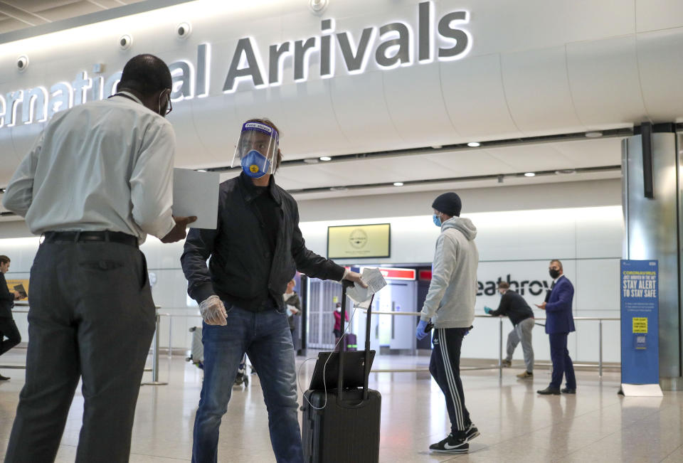 Passengers arrive at Terminal 2 at Heathrow Airport in London, as new quarantine measures for international arrivals come into force.