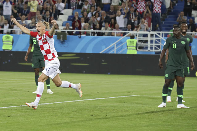 Croatia's Domagoj Vida, left, celebrates after Nigeria's Oghenekaro Etebo, right, scored an own goal during the group D match between Croatia and Nigeria at the 2018 soccer World Cup in the Kaliningrad Stadium in Kaliningrad, Russia, Saturday, June 16, 2018. (AP Photo/Czarek Sokolowski)