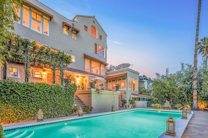 """<p>His name may not be as famous as the shows he's written for and produced, including Netflix's <em>Bridgerton</em> and ABC's <em>Desperate Housewives</em>, but Oliver Goldstick has done some of his best work from the comfort of his circa 1923 Los Angeles home, on the market to the tune of $4 million. Casa Amarilla, the nearly 4,500-square-foot Mediterranean-style home's nickname around the Los Feliz neighborhood, is one of many houses built by silent-film stars of Hollywood's Golden Age.</p> <p>The glamorous home features a balcony that overlooks a Gatsby-inspired soirée space below. On occasion, the wild parties allegedly made their way upstairs to what is currently the primary bedroom's bath and formerly a screening space dubbed """"the rumpus room.""""</p> <p>Price: $3.99 million</p> <p>Beds/Baths: 4 bedrooms, 5 full baths</p> <p>Square Footage: 4,458 square feet</p> <p>For more information, please click <a href=""""https://www.elliman.com/california/sales/detail/512-l-564-81_21730128/2333-n-catalina-st-los-feliz-los-angeles-ca-90027"""" rel=""""nofollow noopener"""" target=""""_blank"""" data-ylk=""""slk:here"""" class=""""link rapid-noclick-resp"""">here</a>.</p>"""
