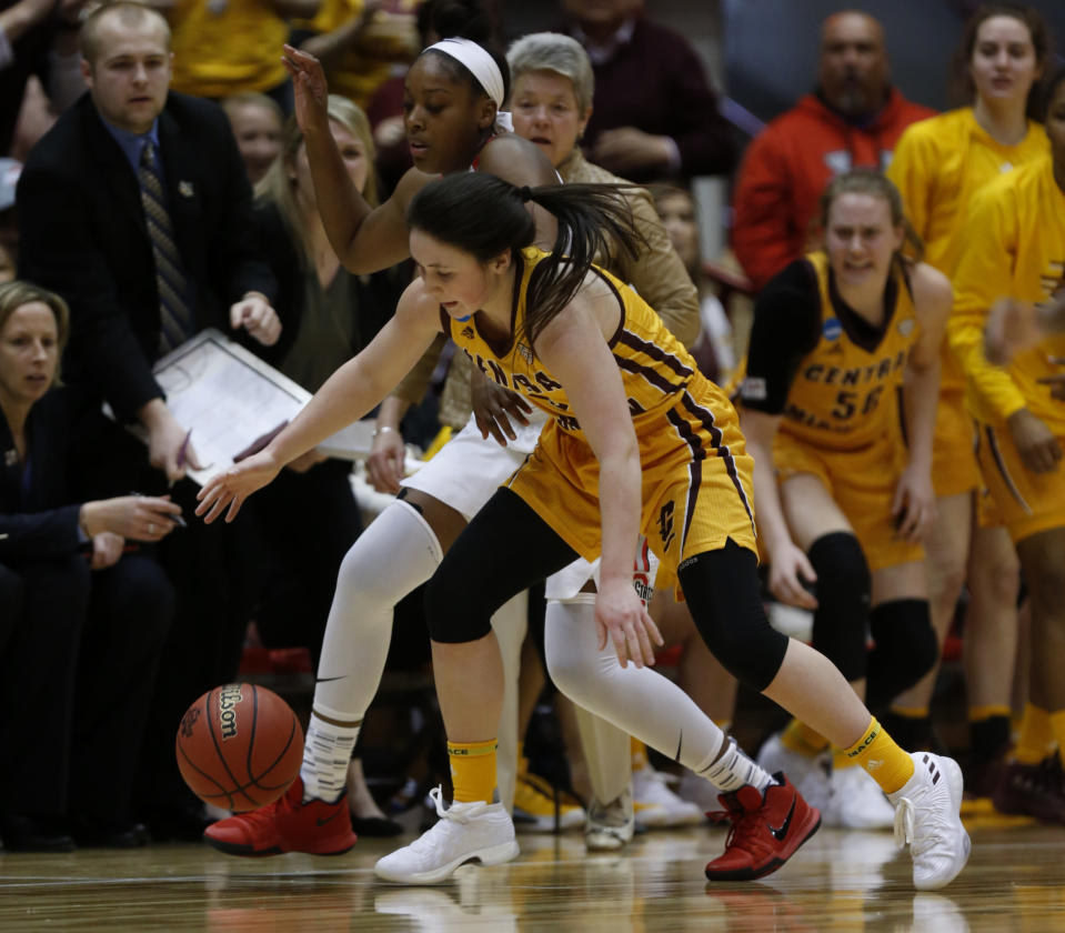 Central Michigan guard Presley Hudson, bottom, chases the ball against Ohio State guard Sierra Calhoun during the first half of a second-round game in the NCAA women's college basketball tournament in Columbus, Ohio, Monday, March 19, 2018. (AP Photo/Paul Vernon)
