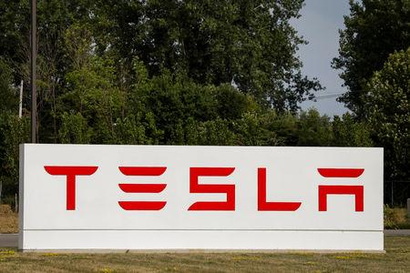 FILE PHOTO: A sign is seen outside the Tesla Inc. Gigafactory 2, which is also known as RiverBend, a joint venture with Panasonic to produce solar panels and roof tiles in Buffalo, New York, U.S., August 2, 2018.  REUTERS/Brendan McDermid