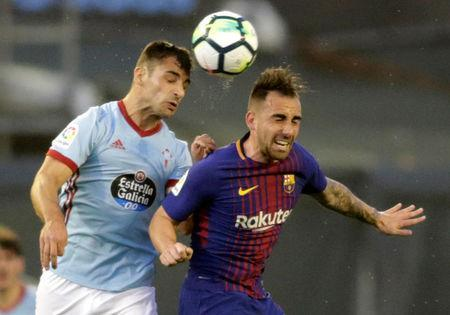 Soccer Football - La Liga Santander - Celta Vigo vs FC Barcelona - Balaidos, Vigo, Spain - April 17, 2018 Celta Vigo's Jonny in action with Barcelona's Paco Alcacer REUTERS/Miguel Vidal