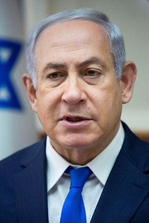 Israeli Prime Minister Benjamin Netanyahu chairs the weekly cabinet meeting at his office in Jerusalem