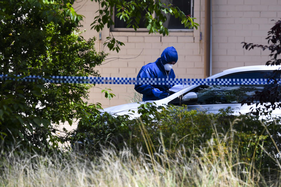 Forensic investigators are seen at a crime scene in the suburb of Page in Canberra. Source: AAP