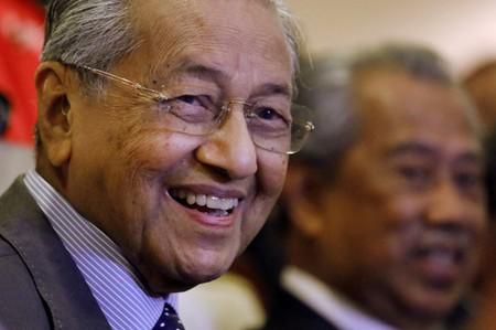 Malaysia's Prime Minister Mahathir Mohamad reacts during a news conference in Putrajaya