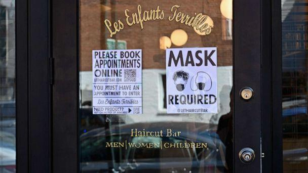PHOTO: A 'Mask Required' sign is seen outside 'Les Enfants Terribles' hair salon and barber shop amid the coronavirus pandemic, June 22, 2020 in Brooklyn, New York City. (Angela Weiss/AFP via Getty Images, FILE)