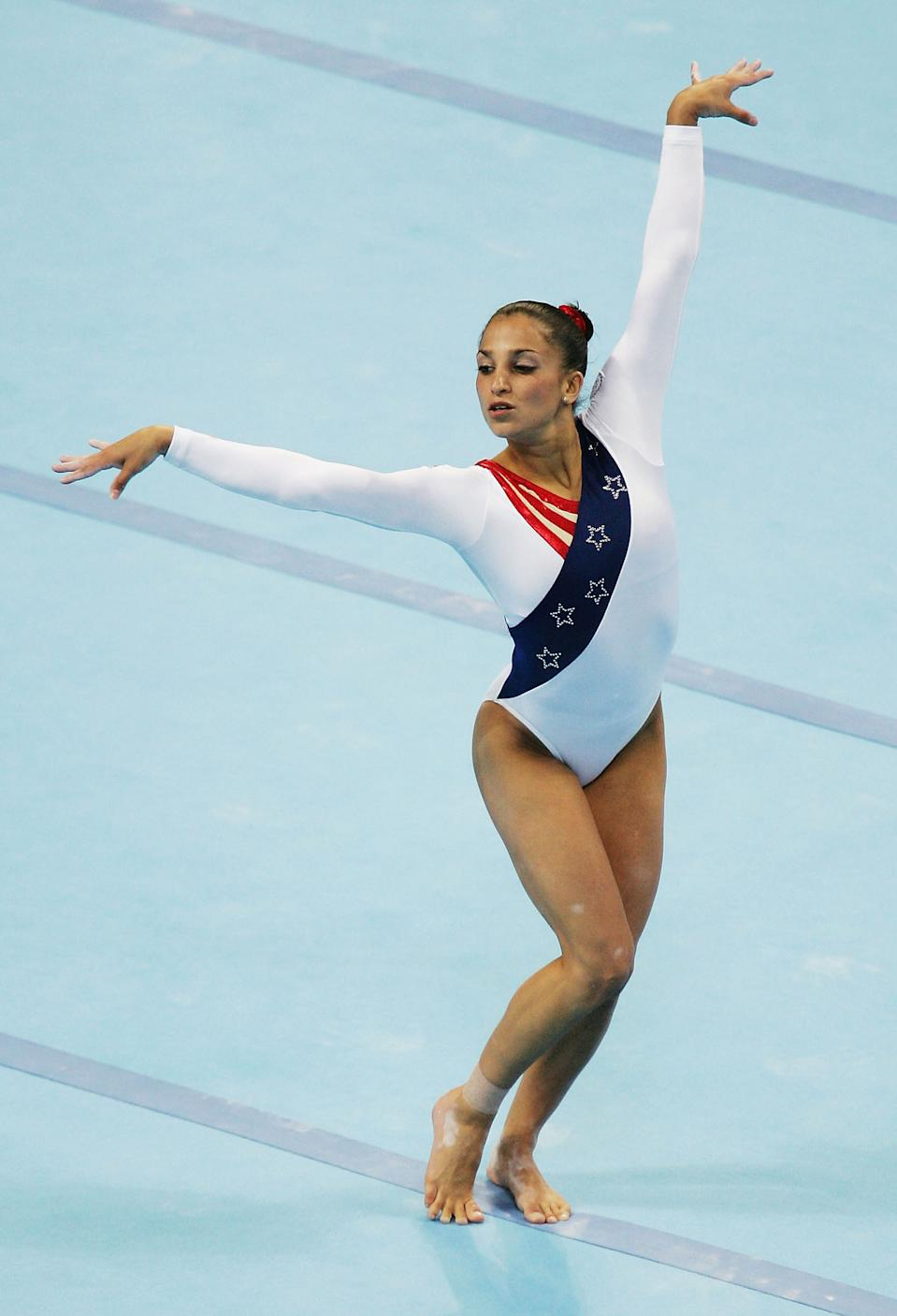 ATHENS - AUGUST 17: Mohini Bhardwaj of the United States competes in the floor excersize at the women's artistic gymnastics team final competition on August 17, 2004 during the Athens 2004 Summer Olympic Games at the Olympic Sports Complex Indoor Hall in Athens, Greece. (Photo by Andy Lyons/Getty Images)