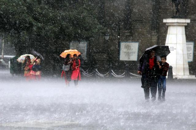 <p>People use umbrellas to shield themselves from heavy rains that lashed Shimla, on September 6, 2018. (Photo: IANS) </p>