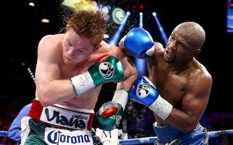 <span>Canelo lost to Mayweather on points in 2015</span> <span>Credit: AP </span>
