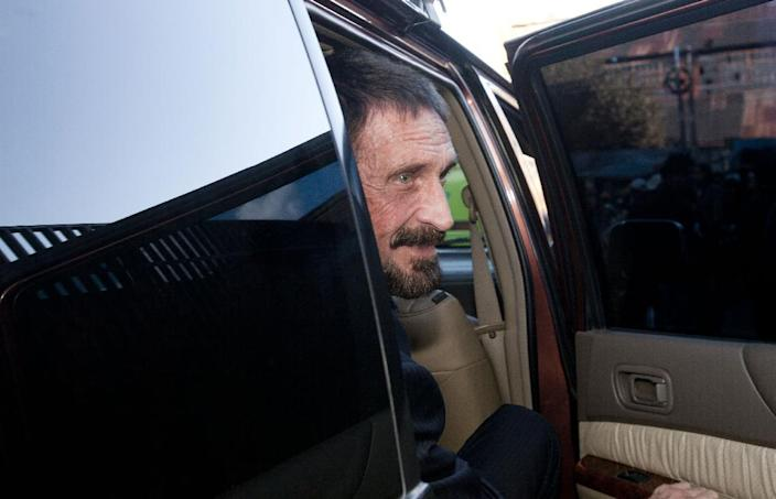 """Software company founder John McAfee poses for pictures after a press conference outside the Supreme Court in Guatemala City, Tuesday, Dec. 4, 2012. McAfee, 67, who has been identified as a """"person of interest"""" in the killing of his neighbor in Belize, 52-year-old Gregory Faull, has surfaced in public for the first time in weeks, saying Tuesday that he plans to ask for asylum in Guatemala because he fears persecution in Belize. (AP Photo/Moises Castillo)"""