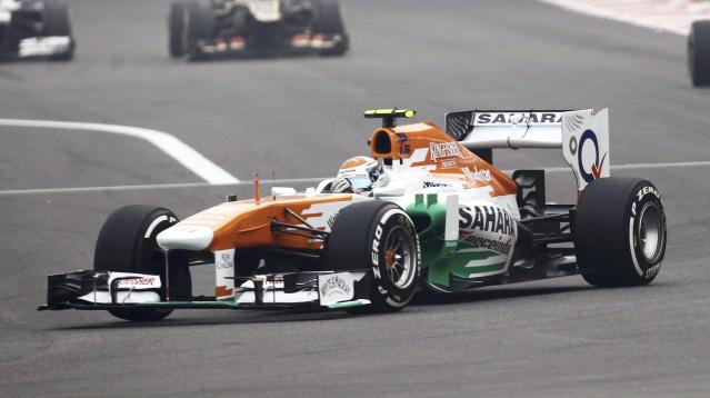 Force India Formula One driver Adrian Sutil of Germany drives during the Indian F1 Grand Prix at the Buddh International Circuit in Greater Noida, on the outskirts of New Delhi, October 27, 2013. REUTERS/Adnan Abidi (INDIA - Tags: SPORT MOTORSPORT F1)