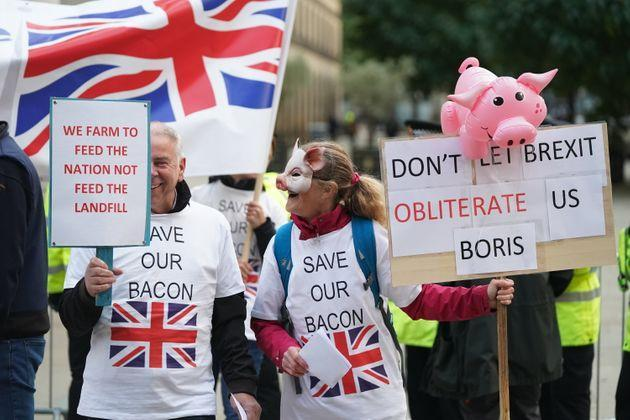 Pig farmers protesting outside the Conservative Party Conference in Manchester this week. (Photo: Stefan Rousseau - PA Images via Getty Images)