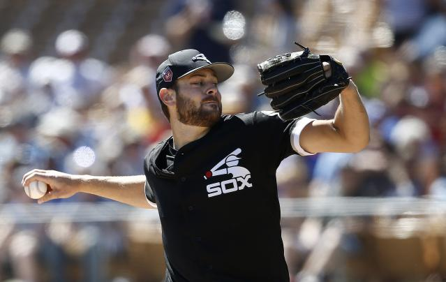 Chicago White Sox starting pitcher Lucas Giolito throws a pitch against the Texas Rangers during the first inning of a spring training baseball game Tuesday, March 20, 2018, in Glendale, Ariz. (AP Photo/Ross D. Franklin)