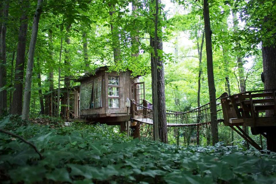 """<p>Fulfill your childhood dreams with this forest fantasy in Atlanta, Georgia, which is one of the most popular Airbnb rentals of all time. The bedroom, living room, and deck are all connected by swinging rope bridges.</p><p><a class=""""link rapid-noclick-resp"""" href=""""https://www.airbnb.com/rooms/1415908"""" rel=""""nofollow noopener"""" target=""""_blank"""" data-ylk=""""slk:BOOK NOW"""">BOOK NOW</a> <strong><em>Secluded Intown Treehouse</em></strong></p>"""