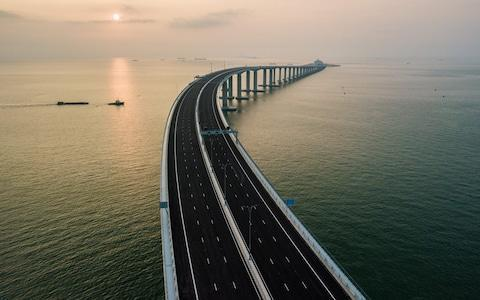 """<span>Hong Kong cars and drivers travelling over the bridge """"must comply with the laws and regulations of the mainland""""</span> <span>Credit: ANTHONY WALLACE/ AFP </span>"""