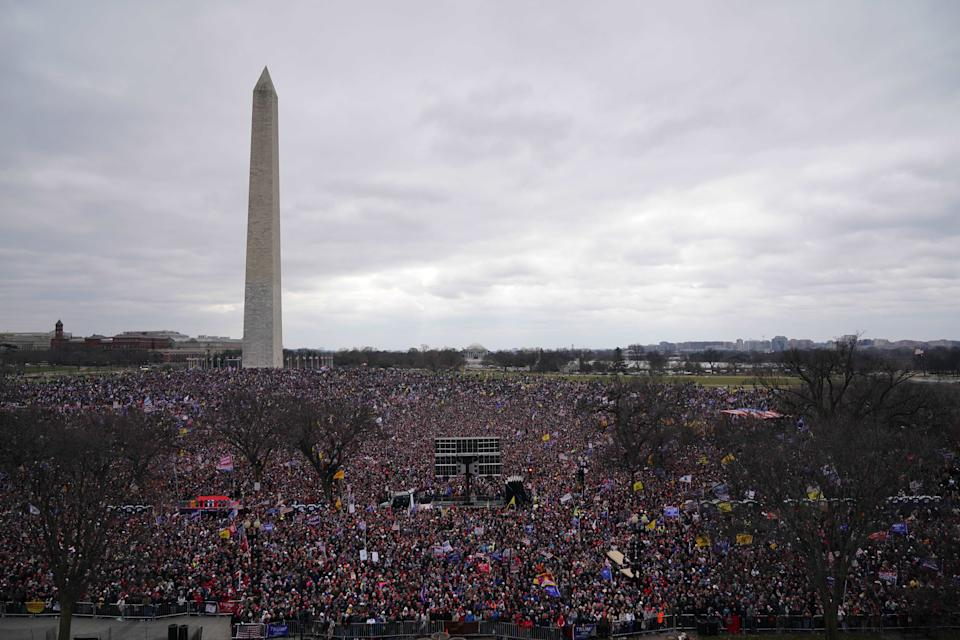TOPSHOT - Crowds of people gather as US President Donald Trump speaks to supporters from The Ellipse near the White House on January 6, 2021, in Washington, DC. - Thousands of Trump supporters, fueled by his spurious claims of voter fraud, are flooding the nation's capital protesting the expected certification of Joe Biden's White House victory by the US Congress. (Photo by MANDEL NGAN / AFP) (Photo by MANDEL NGAN/AFP via Getty Images)