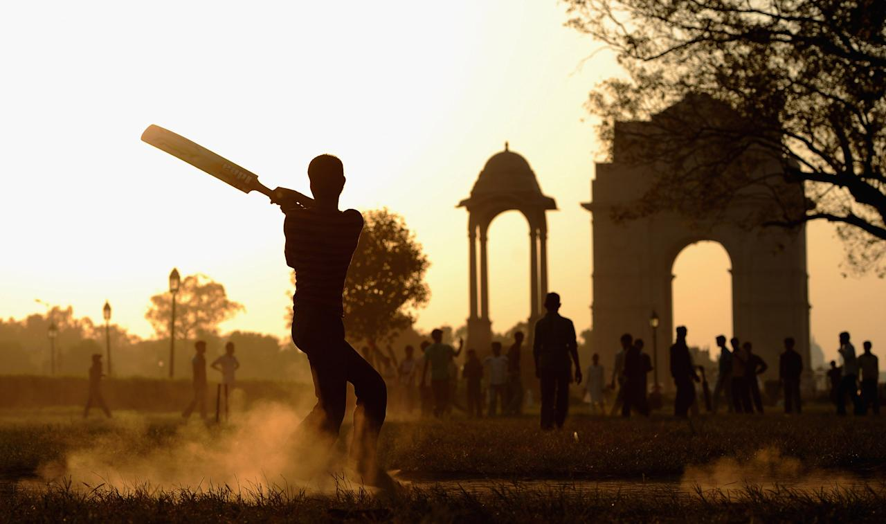 DELHI, INDIA - OCTOBER 16:  Local children play cricket in India Gate Park on October 16, 2011 in Delhi, India.  (Photo by Gareth Copley/Getty Images)