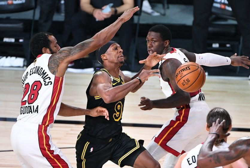ORLANDO, FLORIDA OCTOBER 2, 2020-Lakers Rajon Rondo has the ball knocked away by Heat's Kendrick Nunn, right, but goes out of bounds as Andre Igoudala helps on defense in the 3rd quarter in Game 2 of the NBA FInals in Orlando Friday. (Wally Skalij/Los Angeles Times)