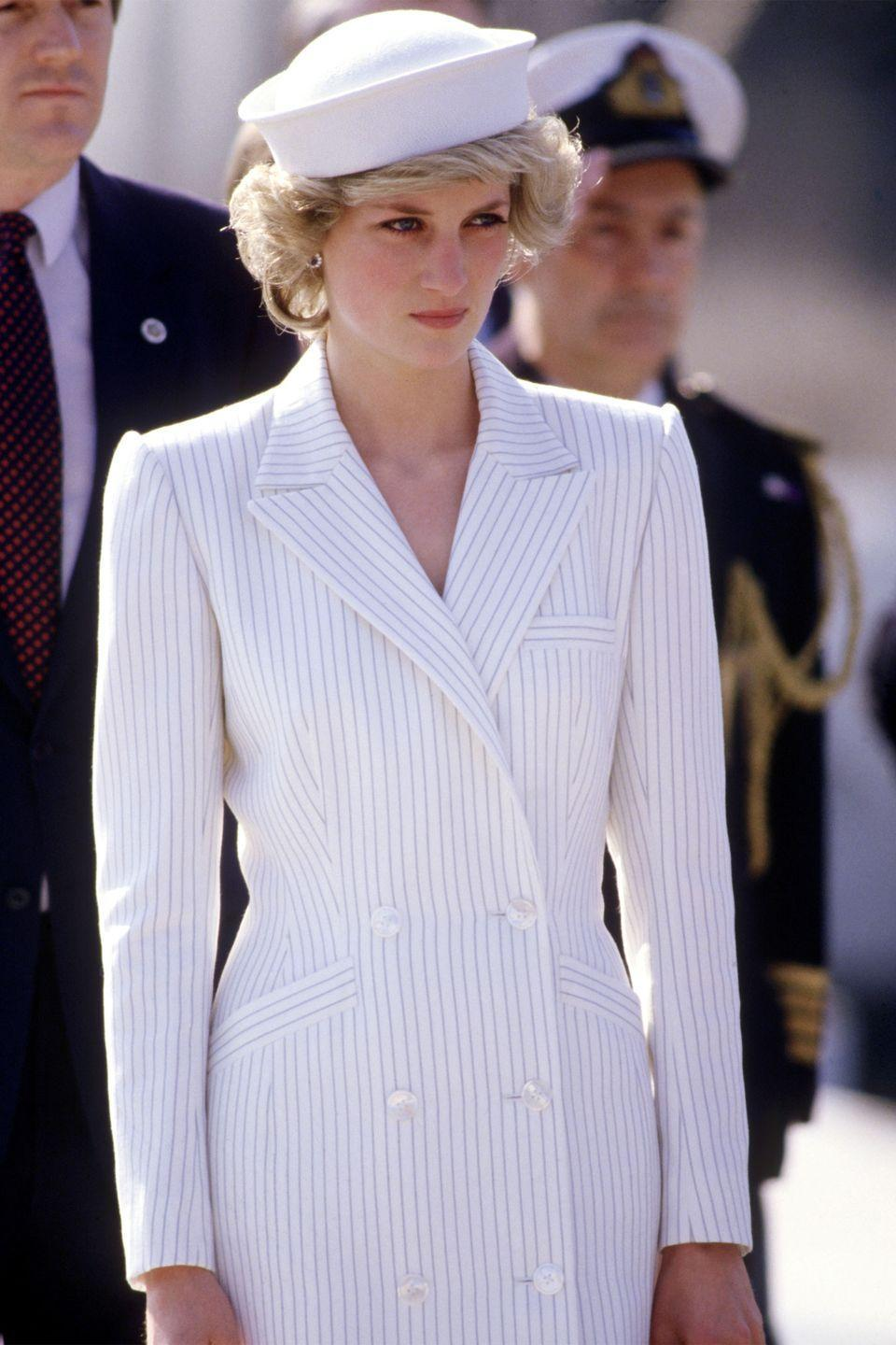 <p>In a dress by Catherine Walker and hat by Kangol arriving at a naval base in La Spezia during the Royal Tour of Italy.</p>