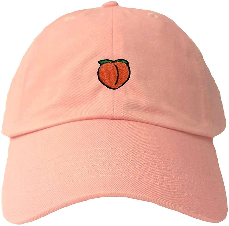 """<h2>Go All Out Peach Emoji Dad Hat<br></h2><br>We all have that friend who's <em>obsessed</em> with this emoji — for them, this embroidered """"dad hat"""" won't disappoint.<br><br><strong>Go All Out</strong> Peach Embroidered Hat, $, available at <a href=""""https://www.amazon.com/dp/B06XY2877D"""" rel=""""nofollow noopener"""" target=""""_blank"""" data-ylk=""""slk:Amazon"""" class=""""link rapid-noclick-resp"""">Amazon</a>"""
