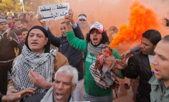 Anti-Morsi protesters shout slogans in front of the presidential palace in Cairo on Feb. 1.