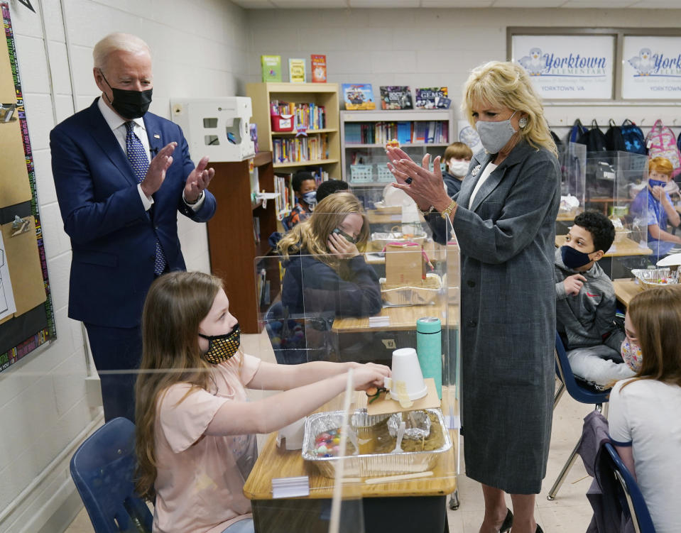 President Joe Biden and first lady Jill Biden applaud a student as she demonstrates her project, during a visit to Yorktown Elementary School, Monday, May 3, 2021, in Yorktown, Va. (AP Photo/Evan Vucci)