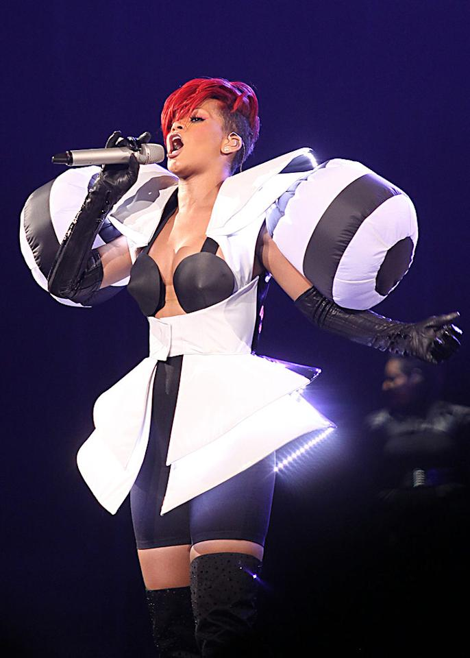 """From head to toe, Rihanna was a complete train wreck while rocking out in Vancouver on her """"Last Girl on Earth"""" tour in a Michelin Man-inspired ensemble, complete with Lycra bike shorts and a catastrophic red coif. R. Chiang/<a href=""""http://www.splashnewsonline.com"""" target=""""new"""">Splash News</a> - July 4, 2010"""