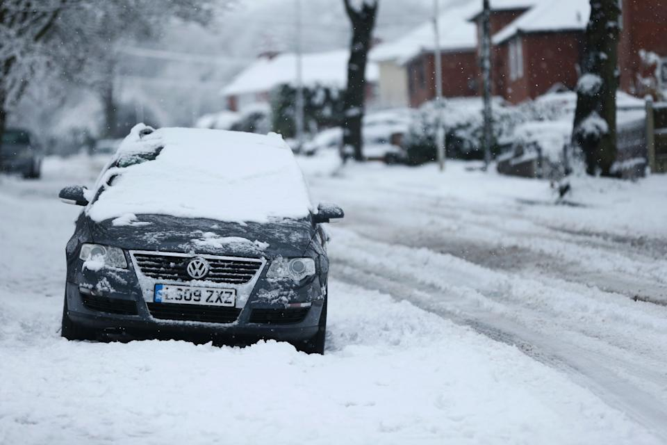 STOURBRIDGE, ENGLAND - DECEMBER 28: Cars abandoned as heavy snowfall falls down on the West Midlands overnight on December 28, 2020 in Stourbridge, England. Heavy snow fall has covered the West Midlands as the Met Office issues yellow warnings throughout the day. (Photo by Cameron Smith/Getty Images)