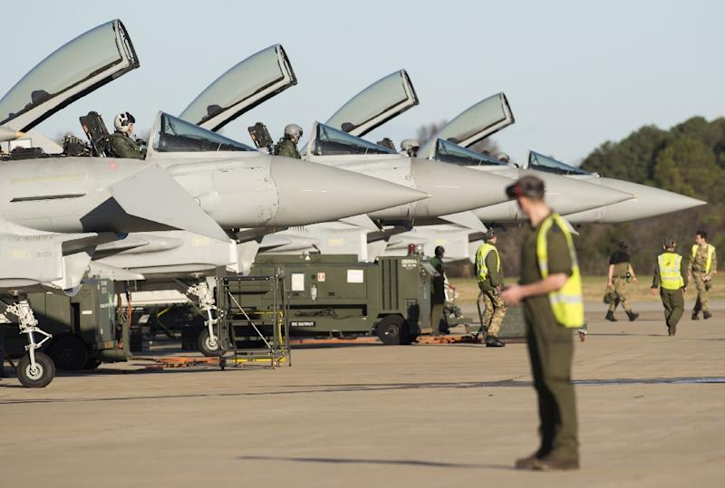 Royal Air Force crews prepare Eurofighter Typhoon aircraft for the inaugural Trilateral Exercise between the US Air Force, United Kingdom's Royal Air Force and the French Air Force on December 15, 2015
