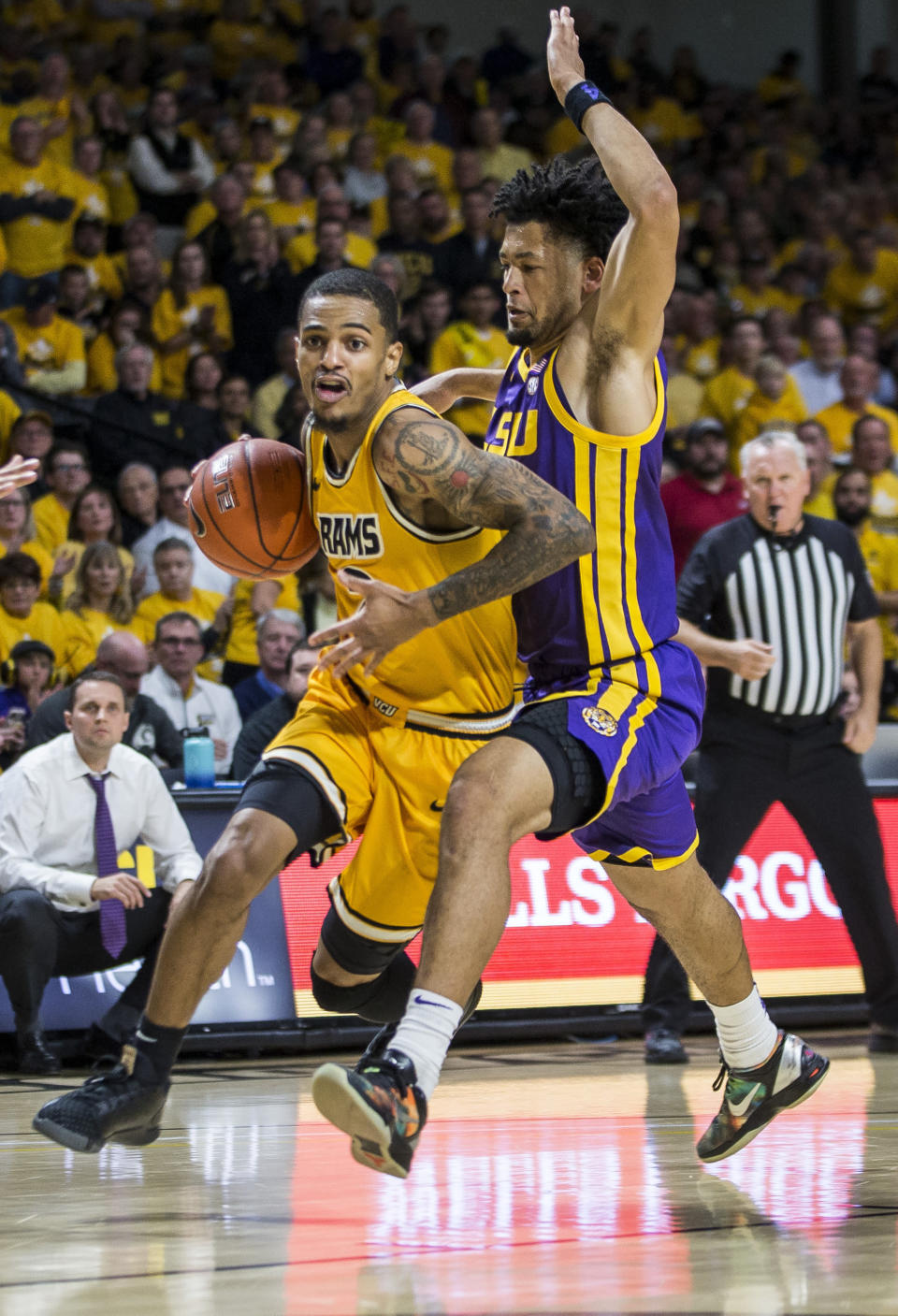 Virginia Commonwealth guard Marcus Evans (2) drives around LSU guard Skylar Mays (4) during the first half of an NCAA college basketball game in Richmond, Va., Wednesday, Nov. 13, 2019. (AP Photo/Zach Gibson)
