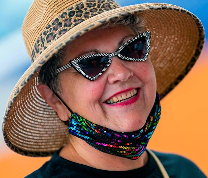 Cynthia Mitchell, from Hope, Kansas, waits in line to board Royal Caribbean's Celebrity Edge cruise ship at Port Everglades Terminal 25 in Fort Lauderdale, Florida on Saturday, June 26, 2021. After departing Port Everglades Saturday, Celebrity Edge will be the first cruise ship sailing with guests from a U.S. port in over 15 months.