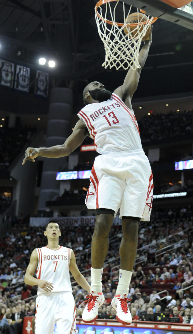 Houston Rockets' James Harden (13) dunks the ball as Jeremy Lin (7) looks on in the second half of an NBA basketball game Saturday, Feb. 1, 2014, in Houston. The Rockets won 106-92. (AP Photo/Pat Sullivan)