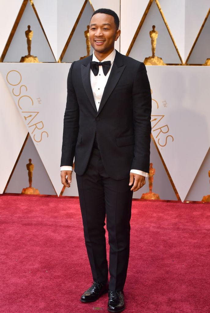<p>John Legend's smile made it pretty obvious he was feeling great in his Gucci tuxedo. <em>(Photo: Getty Images)</em> </p>