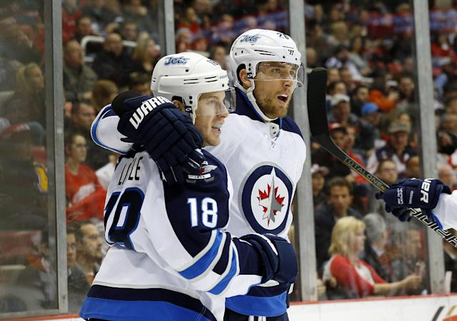 Winnipeg Jets center Bryan Little (18) celebrates his goal against Detroit Red Wings with Blake Wheeler (26) in the first period of an NHL hockey game in Detroit, Tuesday, Nov. 12, 2013. (AP Photo/Paul Sancya)