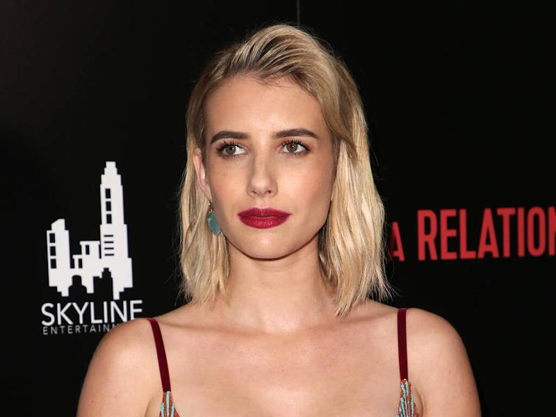 Emma Roberts tops off any holiday party outfit with tights