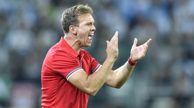 Leipzig's manager Julian Nagelsmann reacts during the German Bundesliga soccer match between Borussia Moenchengladbach and RB Leipzig in Moenchengladbach, Germany, Friday, Aug. 30, 2019. (AP Photo/Martin Meissner)