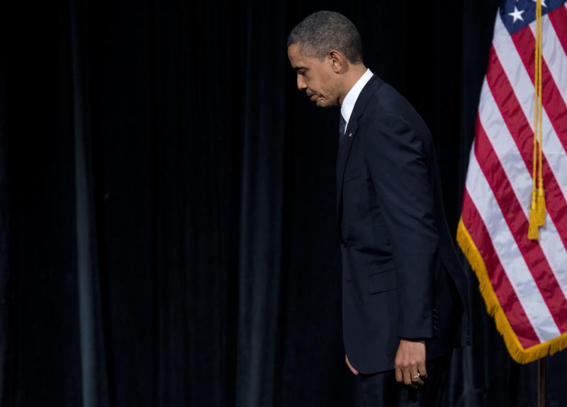 President Barack Obama walks off after delivering a speech at an interfaith vigil for the victims of the Sandy Hook Elementary School shooting on Sunday, Dec. 16, 2012 at Newtown High School in Newtown, Conn. A gunman walked into Sandy Hook Elementary School Friday and opened fire, killing 26 people, including 20 children. (AP Photo/Evan Vucci)