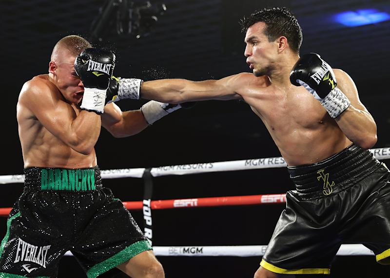 Jose Zepeda vs. Ivan Baranchyk. (Mikey Williams/Top Rank)