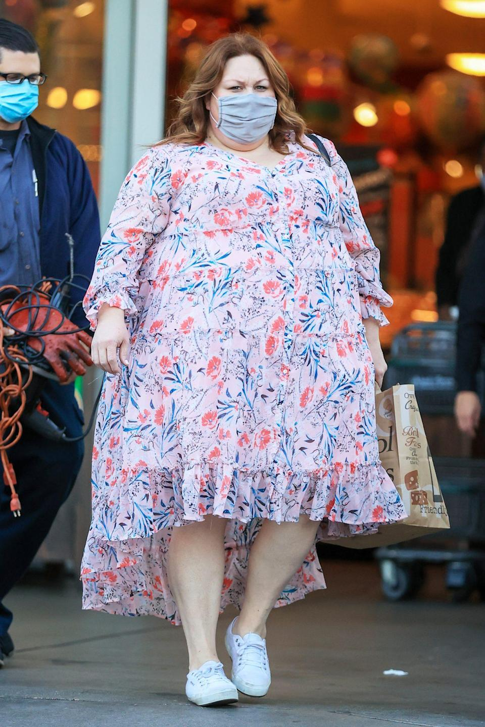 <p>Chrissy Metz looks ready for spring in a tiered floral dress on Thursday at Bristol Farms in L.A.</p>