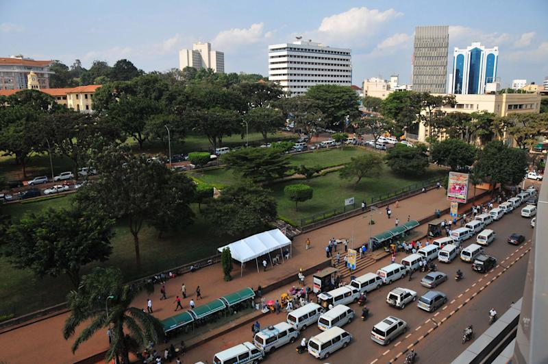 In this Wednesday, June 12, 2013, an aerial view of Constitutional Square in Kampala, Uganda. A public square in Uganda's capital that is closed to the public is becoming a symbol for what many here see as the state's growing intolerance of political dissent. Kampala's Constitution Square, once a cheerful place favoured by politicians, is now protected by armed police with orders to arrest those who attempt to get in. Even the city's mayor has been advised to stay away. (AP Photo/Stephen Wandera)
