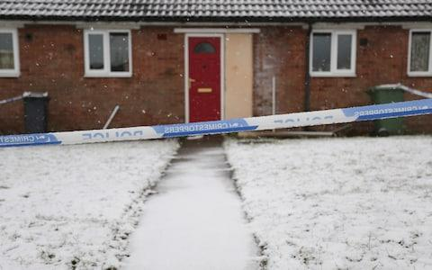 Police tape in front of house - Credit: Laura Dale/Caters News