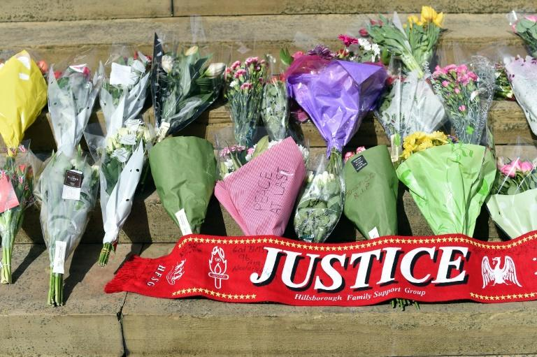 Tributes on the steps of St George's Hall in Liverpool to commemorate the 96 victims of the Hillsborough disaster, on April 27, 2016