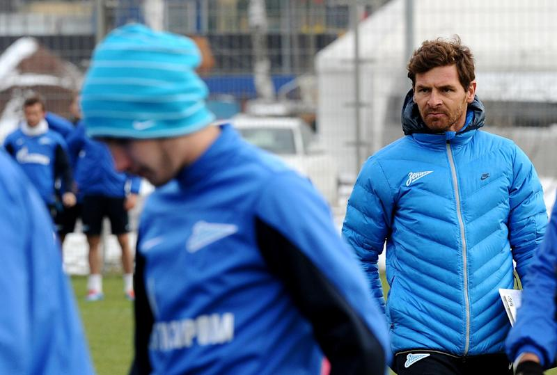 FC Zenit St Petersburg's new head coach Andre Villas-Boas (R) attends a training session with his team in St. Petersburg, Russia, on March 21, 2014