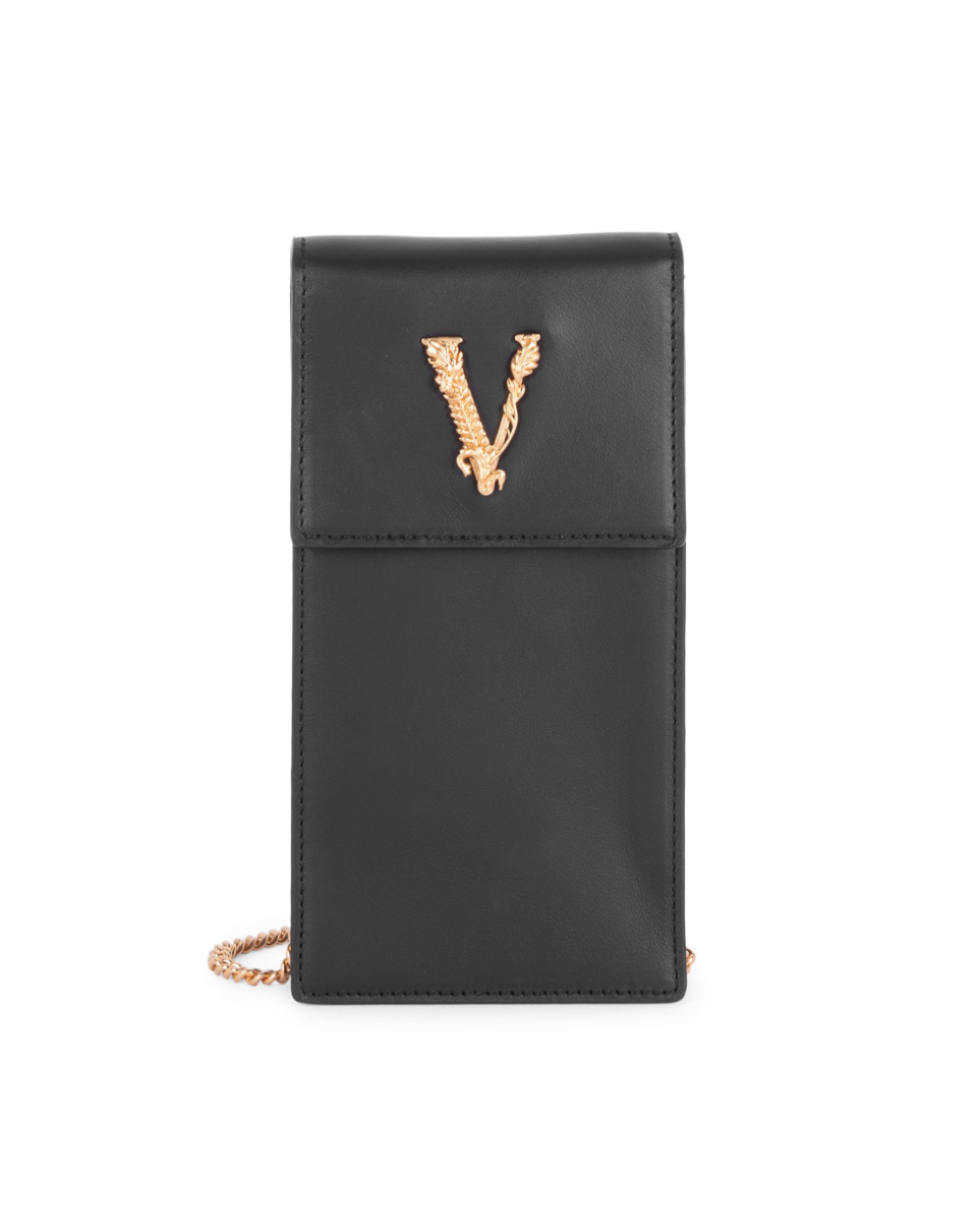 "<p><strong>Versace</strong></p><p>modesens.com</p><p><strong>$675.00</strong></p><p><a href=""https://modesens.com/us/en/product/versace-small-virtus-leather-crossbody-phone-case-black-20137769/?refinfo=gSH_ggfVersafa-ApAc20137769&gclid=CjwKCAjw26H3BRB2EiwAy32zhbR6Ut1oCfwZjuGCH0xc6h0eixFhd0lwZxAGJVnDTfdq0lyVCmJAXhoC2woQAvD_BwE"" rel=""nofollow noopener"" target=""_blank"" data-ylk=""slk:Shop It"" class=""link rapid-noclick-resp"">Shop It</a></p><p>Great for a night on the town, this sleek phone case will pair well with any nighttime look. It holds your phone, ID, and credit card. No extra weight here! </p>"