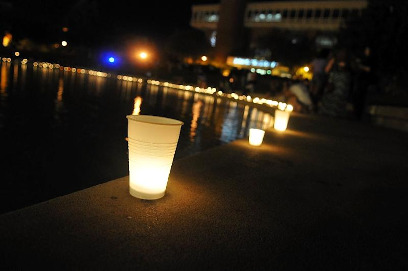 University of Central Florida students attends a candle light vigil held for journalist Stephen Sotloff on September 3, 2014, in Orlando, Florida, who was murdered by the Islamic State