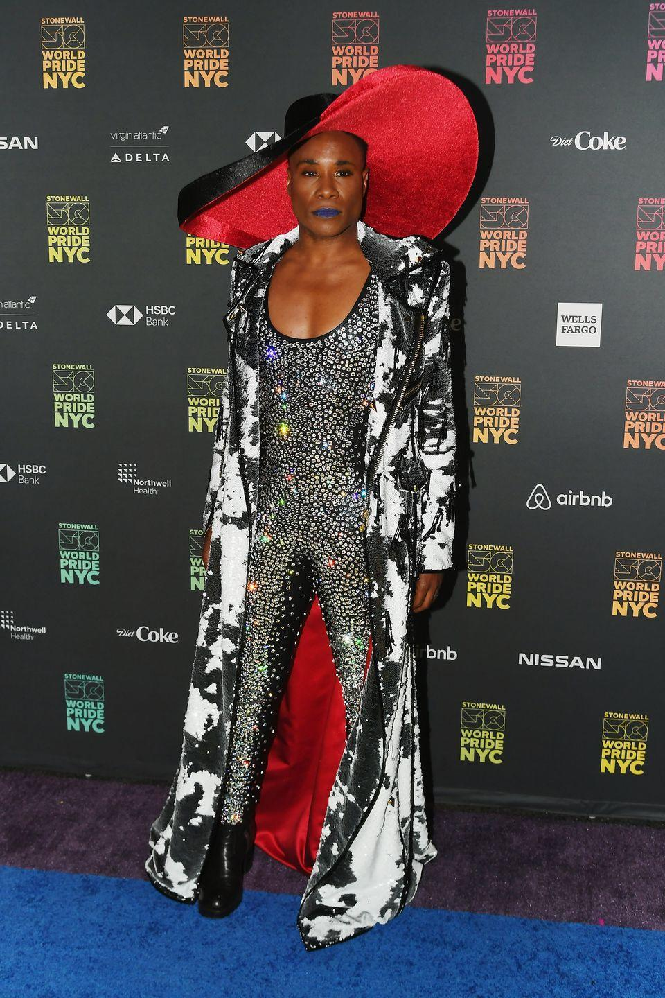 <p>Porter at the 2019 World Pride NYC Opening Ceremony in a rhinestone bodysuit, long black-and-white motorcycle jacket, and a wide-brim hat. </p>