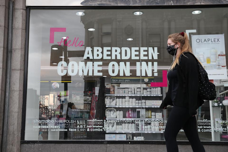 Signage on a shop window on Union Street in Aberdeen after bars, cafes and restaurants were ordered to close on Wednesday. (PA)
